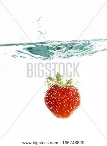 strawberry close up thrown into the water