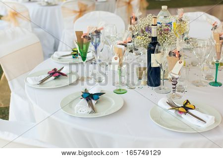 Beautifully served wedding table with a lot of decorations