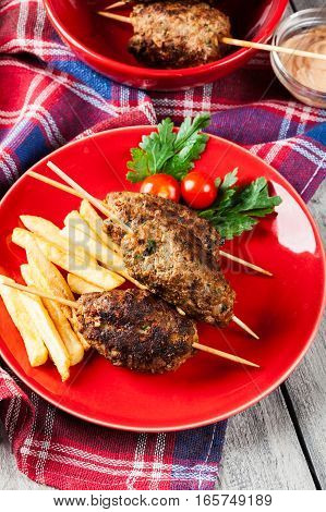 Barbecued Kofta With Fries On A Plate