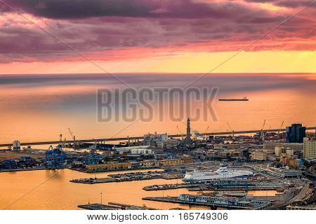 Genoa Italy cityscape with sea, harbor and antique lantern.