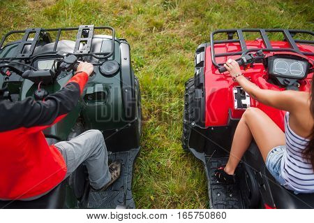 Couple Sitting On Four-wheeler Atv