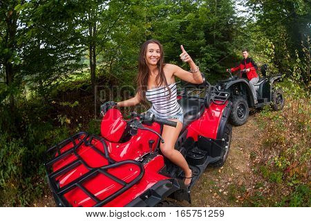 Happy Couple Driving Four-wheelers Atv