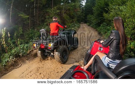 Couple Driving Four-wheelers Atv Offroad