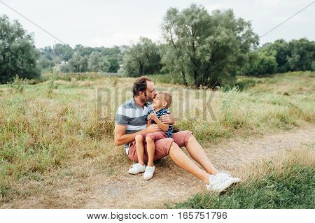Happy Father And Son Playing Together