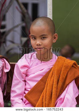 SAGAING MYANMAR - NOVEMBER 22 2016: Potrait of Buddhist nun between lessons