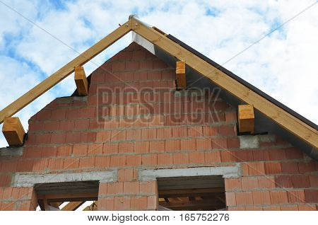 Roofing Construction Details Exterior. Rooftop View on Roof Installation. Roofing Systems