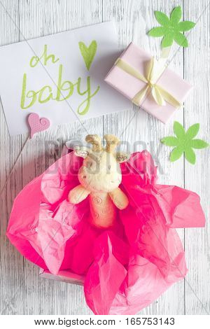 birth of girl - baby shower concept on wooden background top view