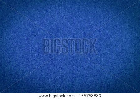 Blue paper with vignette, a background or texture