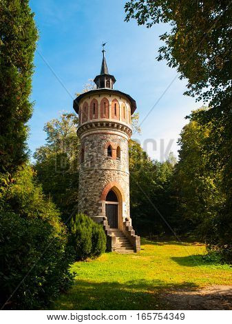 Romantic rounded waterworks tower in the park near Sychrov Castle, Czech Republic, Europe.