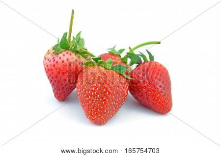 Collection of strawberry fruits of different shaped isolated on white background.Arranged in a heart shape.