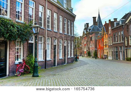 Street view, traditional houses and bicycles in Leiden, Holland, Netherlands