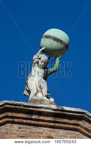 Little Atlas old statue holding up the globe in Venice