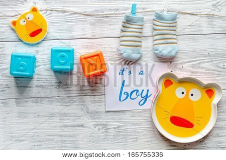 birth of boy - baby shower concept on wooden background top view
