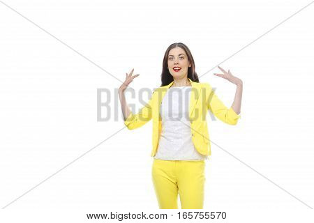 Portrait of a beautiful young woman looking astonished against a white background.