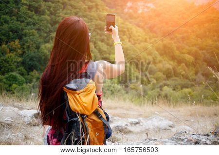 Girl with backpack pictures of mountain landscape