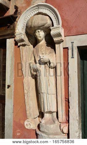 Muslim merchant medieval statue near Moorish Square in Venice