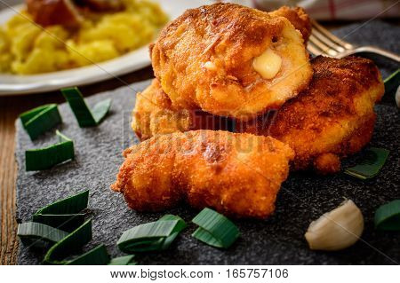 French traditional cuisine chicken cordon bleu with cheese and ham