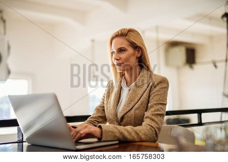 A young female working from home on a computer.
