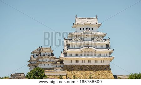 Closeup view of Himeji castle against blue sky in Japan