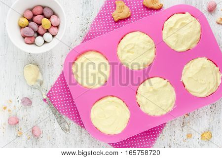 Easter nest cake cooking Easter recipe step by step preparation of Easter dessert mini cheesecakes with candy eggs