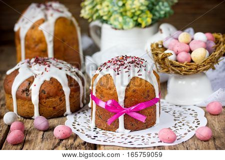Traditional Easter cake and colorful chocolate candy eggs on festive Easter table