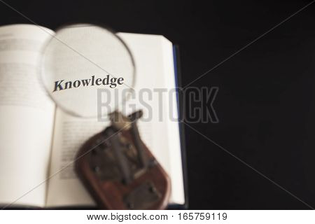 Knowledge Education conceptual Magnifying glass on Book Study Reading