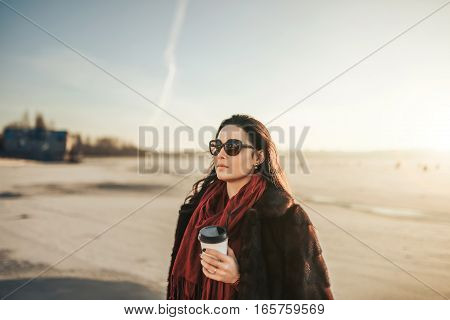 Brunette Girl Walk Outdoor In The Park With Cup Of Coffee