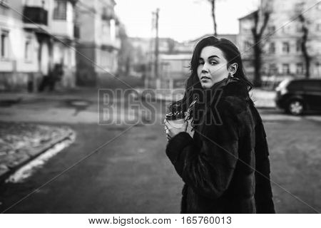 Pretty Brunette Girl Walking Outdoor With Coffee