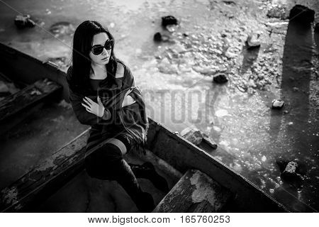 Brunette Girl Sitting Outdoor In The Old Boat