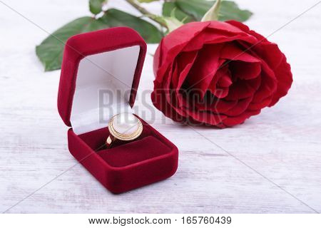 Diamond wedding ring in a red gift box