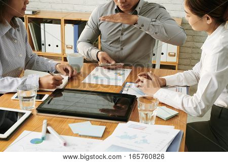 Businessman presenting his idea to colleagues at meeting