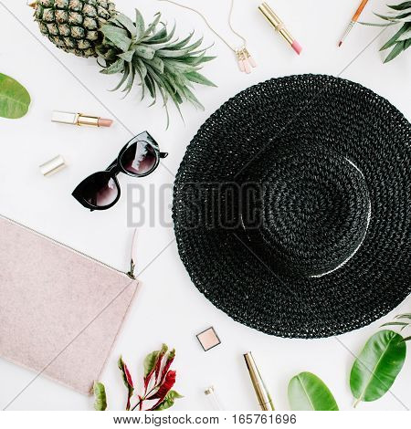 Summer casual style. Modern woman clothes and accessories collage. Hat sunglasses purse lipstick and pineapples. Flat lay top view