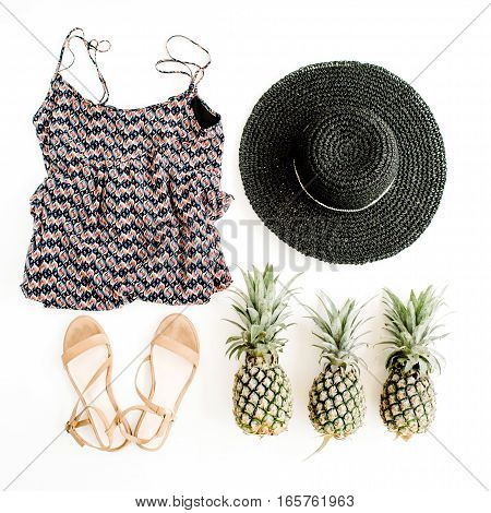 Stylish trendy feminine clothes accessories and pineapples. Flat lay top view