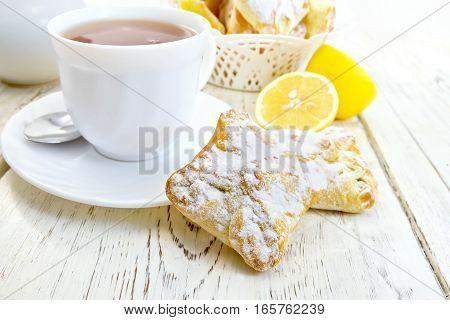 Cookies Lemon With Tea On Light Board