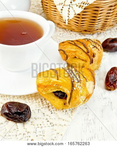 Cookies With Dates And Tea In Cup On Board