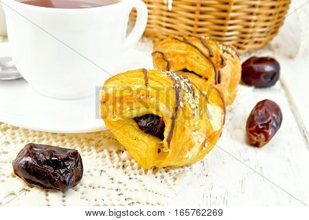 Cookies With Dates And Tea In White Cup On Board