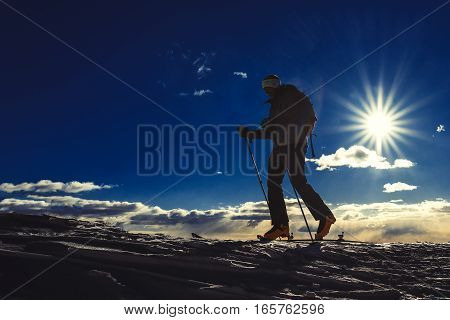 A man practice ski mountaineering alone in mountain