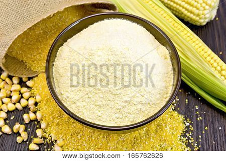 Flour Corn In Bowl With Grits And Cob On Dark Board