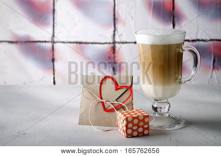 Coffee Latte with gift boxes, envelope and paper hearts. Pink, red, white colors on bright background. Love, Valentine's day concept. Copy space, horizontal