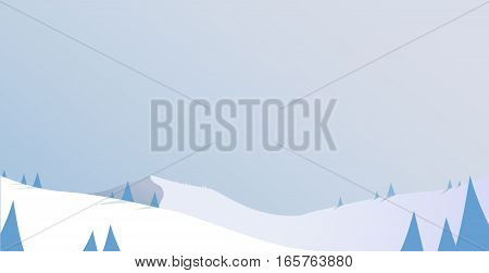 Winter mountain scenery with pine trees and snowy hills - day light scenery