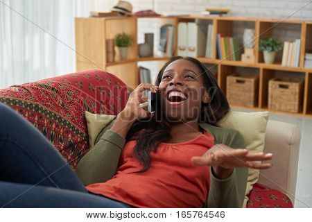 Woman laughing when talking on phone with friend