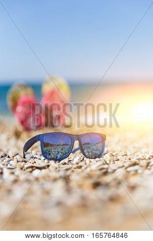 Photo of sunglasses on sea shore day