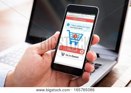 Close-up Of A Person Hand Shopping Online On Mobile Phone