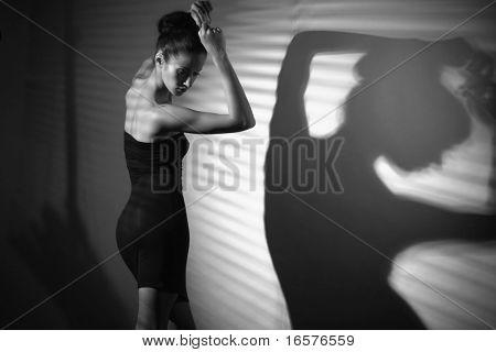 sexy woman in black dress dancing