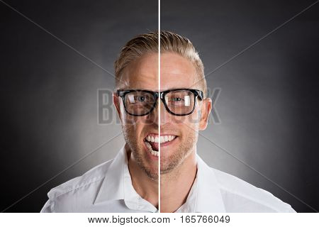 Man's Face Showing Anger And Happy Emotions Against Black Background