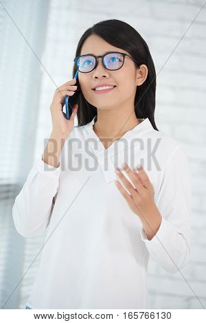 Female entrepreneur consulting client on the phone