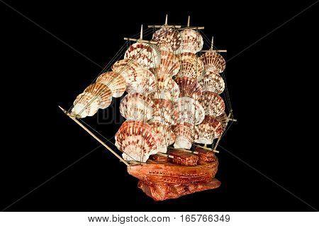 Ship Sailboat Wooden Model Figurine on a Black Background
