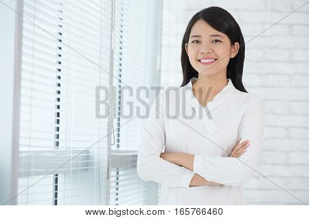 Smiling pretty business lady looking at camera