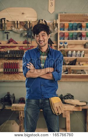 Portrait of Asian carpenter smiling and looking at camera