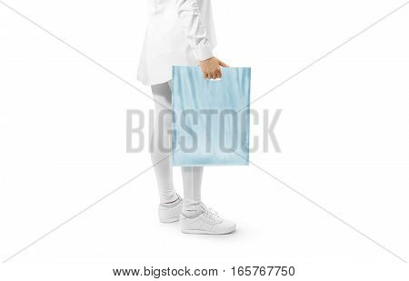 Blank blue plastic bag mockup holding hand. Woman hold plain carrier sac mock up. Polythene bagful branding template. Shopping carry package in persons arm. Promo packet for logotype branding.